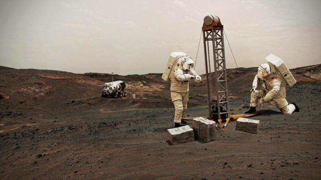 火星の表面を掘削するNASAの宇宙飛行士の想像図(Credit: NASA)